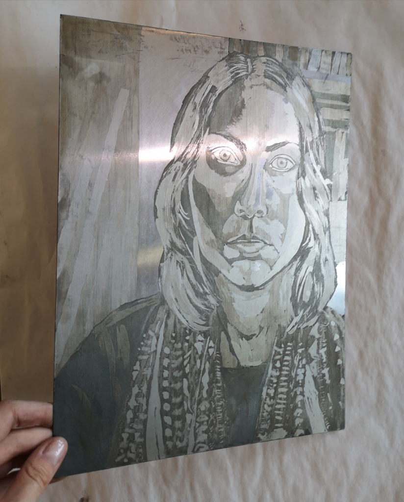 Metal plate etched with the aquatint technique