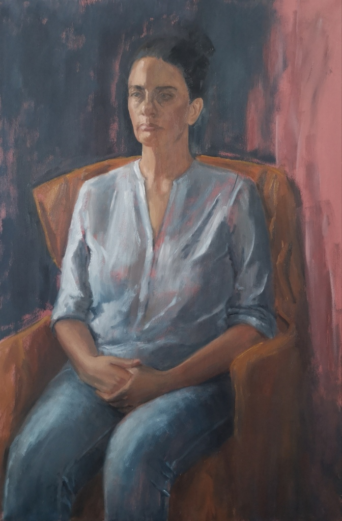 Oil Portrait on canvas of a melancholic seated woman wearing blue jeans by Clara Niniewski