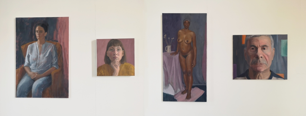 Panorama of exhibited oil portrait paintings by Clara Niniewski at Heatherley's School of Fine Art on Lots Road, Chelsea, London